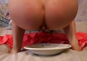 Busty woman eats her shit
