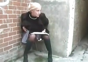 Brave woman peeing outdoors