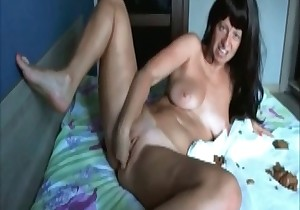 Brunette plays with her turd