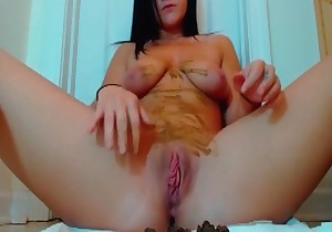 Busty brunette smudging her shit